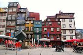 Multicolored Houses On Ribeira Square, Porto, Portugal.