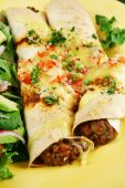 stock photo of enchiladas  - Beef and red kidney bean enchiladas with cheese and salad - JPG