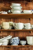 stock photo of crockery  - Wooden crockery in the pantry in the kitchen - JPG