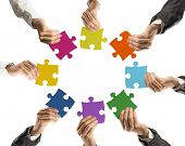 foto of missing  - Concept of teamwork and integration with businessman holding colorful puzzle - JPG