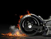 stock photo of biker  - Custom motorcycle burnout on a black background - JPG