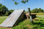 picture of safe haven  - An Old Underground Storm Cellar or Tornado Shelter in Rural Oklahoma - JPG