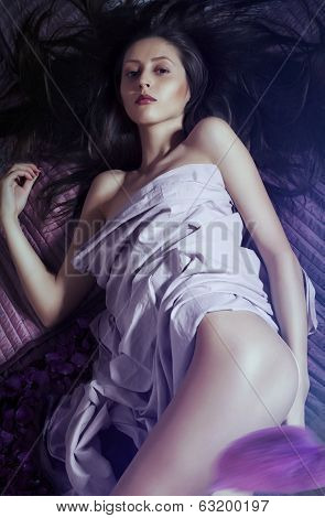 girl on the bed with rose petals