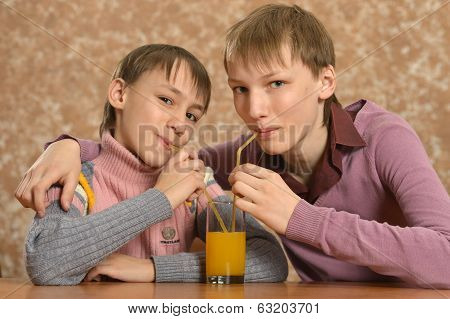 Two boys drinking