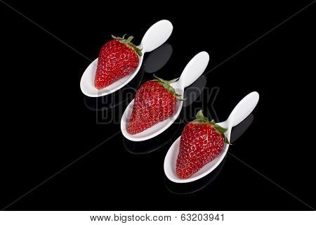 Three Strawberries In Faience Spoons