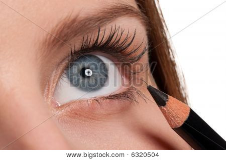 Close-up Of Blue Eye, Woman Applying Black Pencil