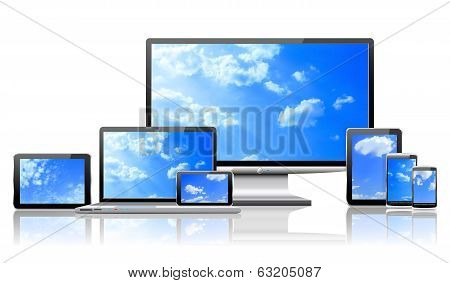 Computers And Cloudy Sky Concept.