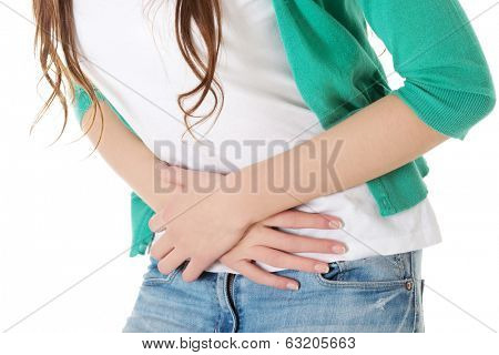 Young beautiful woman is having stomach ache. Isolated on white.