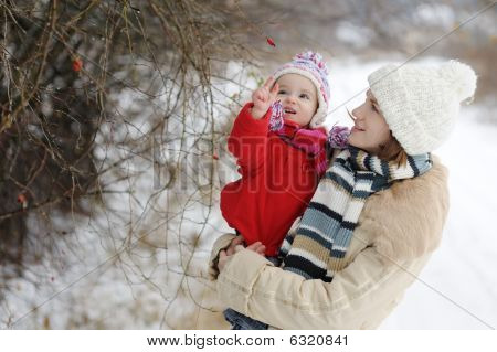 Little Winter Baby Girl And Her Young Mother