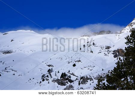 Fresh Ski Slope And Mountains In Sunny Day