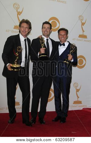 LOS ANGELES - SEP 22: John de Mol, Carson Daly, Mark Burnett in the press room during the 65th Annual Primetime Emmy Awards held at Nokia Theater L.A. Live on September 22, 2013 in Los Angeles, CA