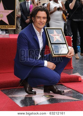 LOS ANGELES - APR 02:  Orlando Bloom arrives to the Walk of Fame honors Orlando Bloom  on April 02, 2014 in Hollywood, CA