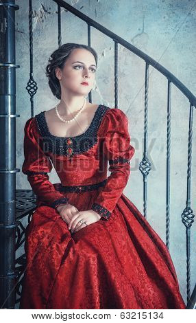 Beautiful Woman In Medieval Dress On The Stairway