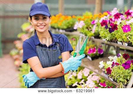 beautiful young small nursery business owner portrait in greenhouse