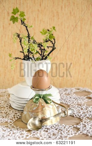 Easter Eggs In Eggcups With Gold Spoons