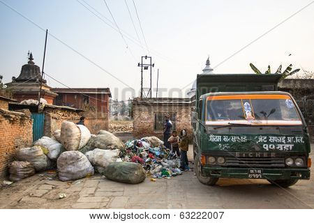 KATHMANDU, NEPAL - DEC 19, 2013: Unidentified people from poorer areas working in sorting of plastic on the dump. Only 35% of population have access to adequate sanitation.