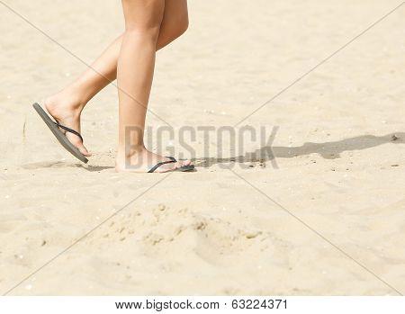 Walking On Beach With Flip Flops