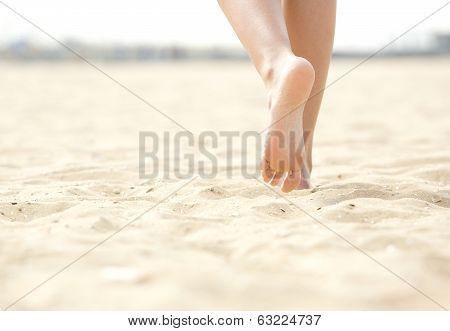 Woman Barefoot Walking On Beach