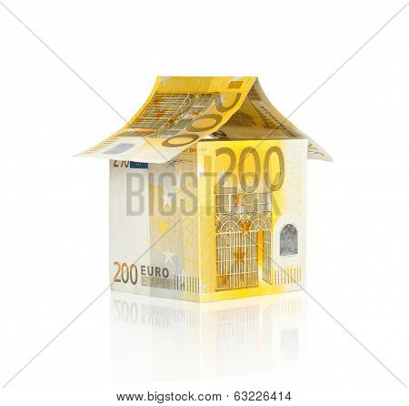 House made from euro bills isolated on white background