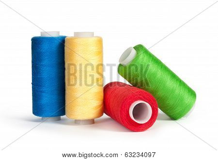 bobbins thread with needle and sewing pin isolated on white