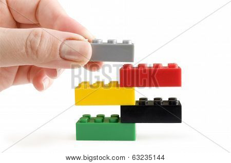 Children's Designer of the bricks. The photo on white background