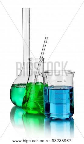 Beakers and laboratory glassware isolated over white background with reflections - With clipping pat