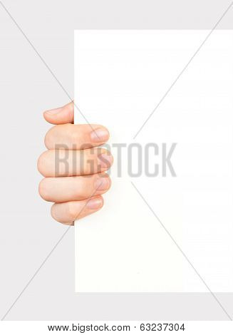 hand holding white paper page