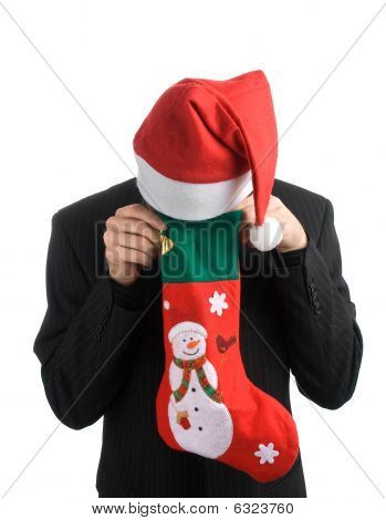 Man In A Christmas Hat With A Christmas Stocking