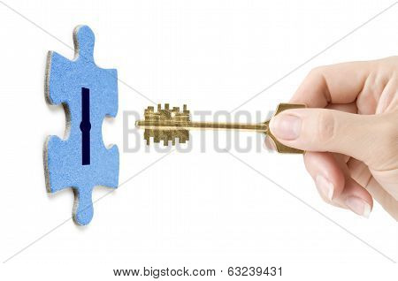 key in hand opening lock in puzzle
