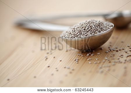 One Full Table Spoon White Chia Seeds On A Cutting Board
