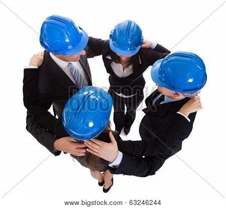 Happy Architects Making Huddle
