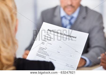 Businesswoman Holding Application Form