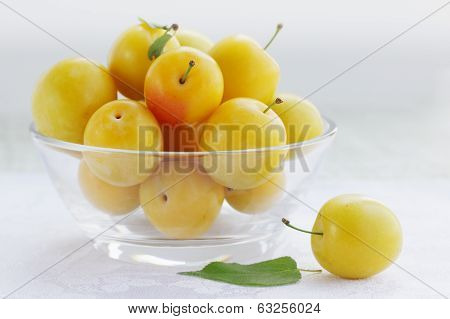 plum in transparent bowl