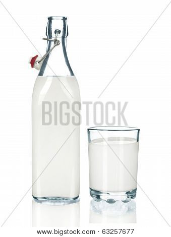 Glass of milk and bottle on white background