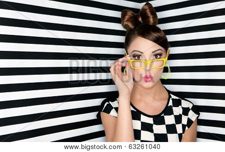 Attractive surprised young woman wearing glasses on checkered background, beauty and fashion concept