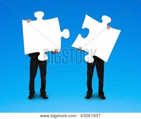 Two Businessmen Assembling Puzzles