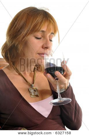 Smelling A Wineglass