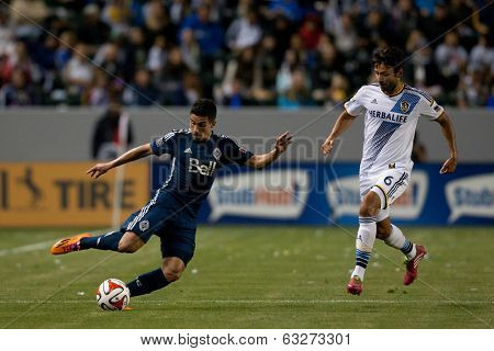 CARSON, CA - APRIL 12: Los Angeles Galaxy M Baggio Husidic #6 & Vancouver Whitecaps M Sebastian Fernandez #7 during the MLS game between the Los Angeles Galaxy & the Vancouver Whitecaps April 12 2014