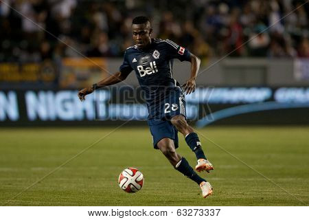 CARSON, CA - APRIL 12: Vancouver Whitecaps M Gershon Koffie #28 during the MLS game between the Los Angeles Galaxy & the Vancouver Whitecaps on April 12th 2014 at the StubHub Center.