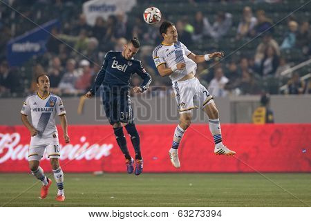 CARSON, CA - APRIL 12: Los Angeles Galaxy M Stefan Ishizaki #24 & Vancouver Whitecaps M Russell Teibert #31 during the MLS game between the Los Angeles Galaxy & the Vancouver Whitecaps April 12 2014