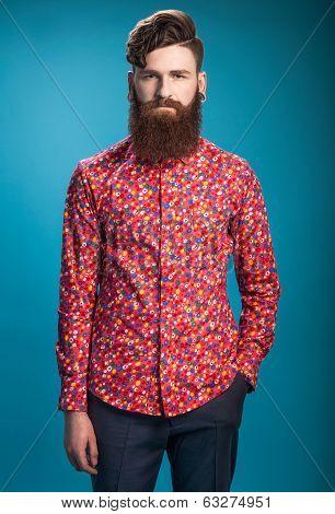Stylish man with beard on blue background
