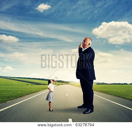 angry businesswoman screaming at big yawning man on the road