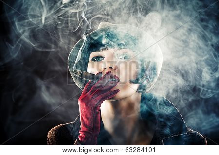 glamorous woman in retro style with cigar