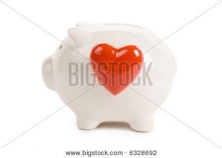 Hucha y corazón rojo