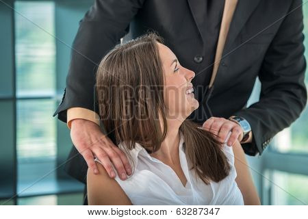 Business woman having fun with colleague at workplace