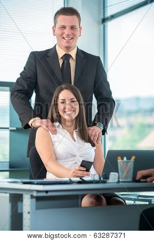 Happy business people posing in office
