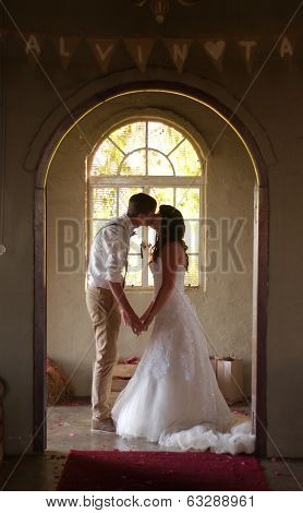 Bride And Groom Kissing Inside Church