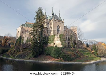 Scenic View Of Autumn Bojnice Castle With Moat In Foreground