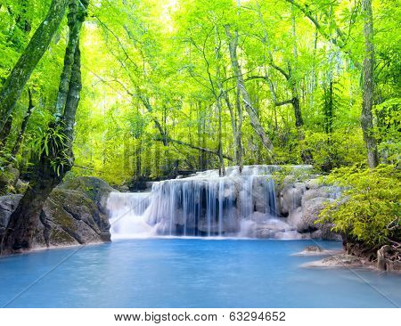 Tropical waterfall in Thailand, nature photography. Fresh water mountain river in wild green jungle  poster