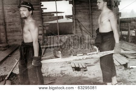RUSSIA, CIRCA 1970's: Vintage photo of two construction workers working